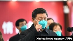ارشیف، شی جین پنگ رئیس جمهور چین حین دیدار از شهر ووهان.