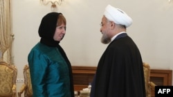 Iranian President Hassan Rohani (right) meets with EU foreign-policy chief Catherine Ashton in Tehran in March.