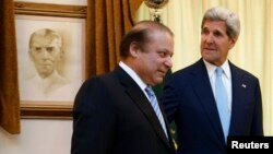 Pakistani Prime Minister Nawaz Sharif (left) meets with U.S. Secretary of State John Kerry in Islamabad on August 1.