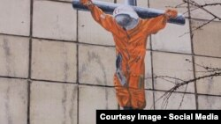 Гагарин на кресте. Граффити Александра Жунева в Перми