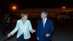 Атамбаев Меркель билан учрашув чоғида Европа ва Россияни муросага чақирди