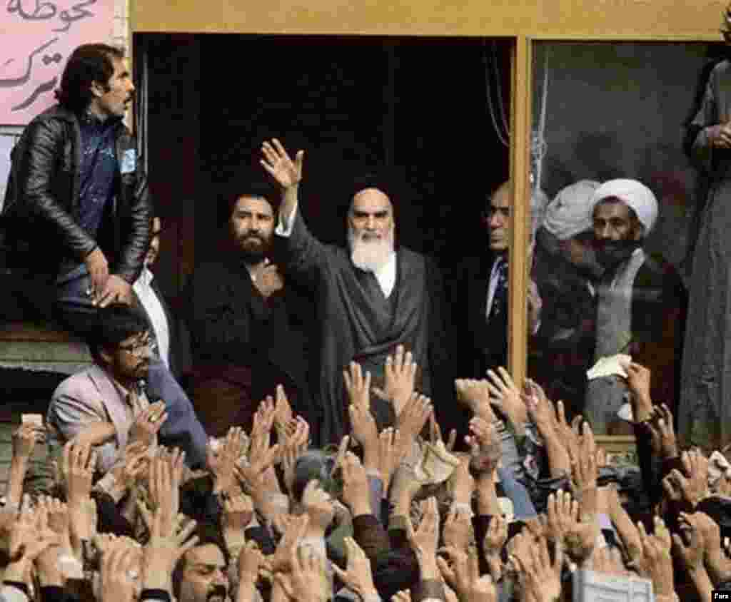 Khomeini addresses adoring crowds with his son Ahmad on February 1, 1979.