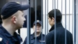Petersburg, stands inside the defendant's cage as he attends a court hearing in Moscow, Russia, April 18, 2017