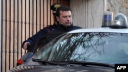 """Costa Concordia"" Captain Francesco Schettino is escorted into custody by a policeman in Grosseto on January 14, one day after the tragedy."