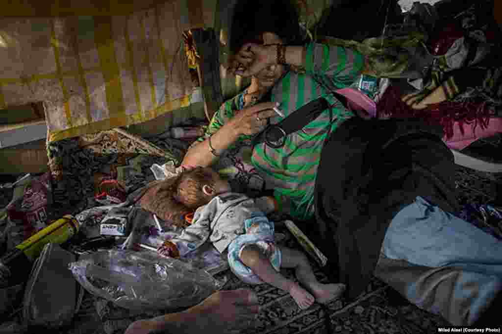 This photo was from a series about two heroin addicts and their newborn baby. Alaei said it was not published because the woman is not wearing the hijab.