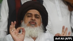 FILE: Khadim Hussain Rizvi, ultra-religious Tehreek-e-Labaik Pakistan (TLP) party, gestures as he speaks to media in Lahore in July.