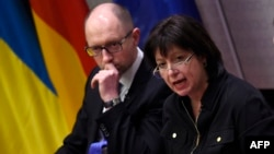 Ukrainian Prime Minister Arseniy Yatsenyuk (left) and Finance Minister Natalie Jaresko are in Washington this week to meet with the International Monetary Fund (IMF), promote Ukraine as an investment destination, and ask U.S. officials for more economic and military support.