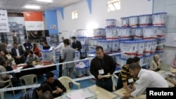 Officials audit suspect ballots at a counting center in Kirkuk on March 18.