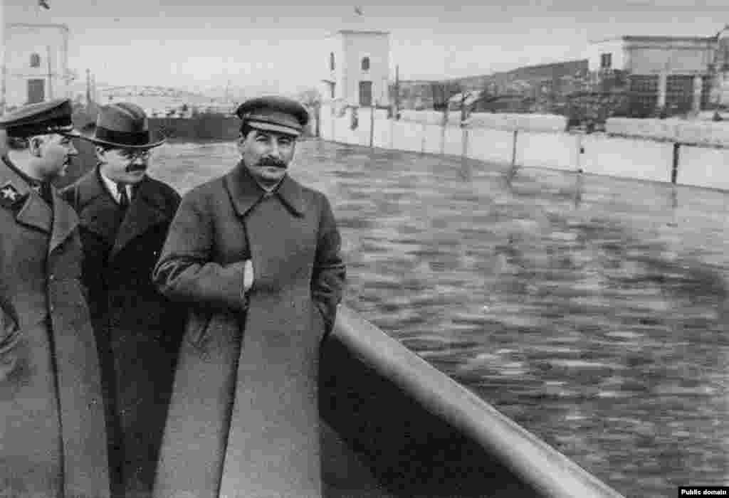 "After Yezhov himself was executed, the photos of Stalin and his honchos strolling along a Moscow canal was neatly updated to remove ""the poison dwarf."""