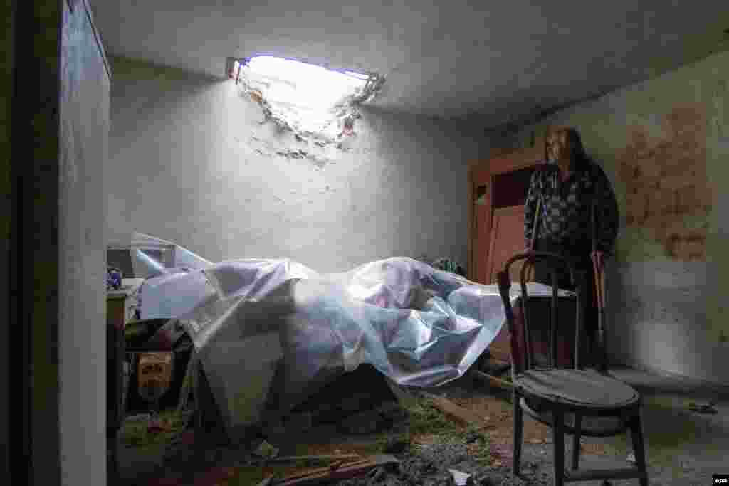 A man stands in his damaged house after recent shelling in eastern Ukraine's Donetsk region. (epa/Sergey Vaganov)