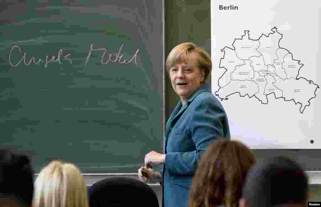 Merkel deliveres a lecture about the Berlin Wall at Heinrich Schliemann Gymnasium, a secondary school in Berlin, in August 2013.