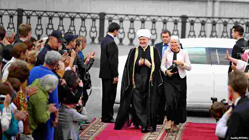 Mufti Ravil Gaynutdin, the head of the Council of Muftis of Russia and the festival's president, arrives with his wife for the opening ceremony.