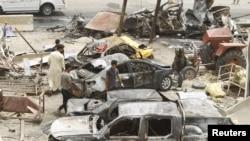 На месте теракта в Багдаде 18 июля 2015 года.