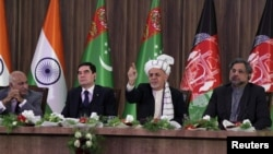 Afghan President Ashraf Ghani (2nd right) speaks during the inauguration of TAPI pipeline construction work, while Pakistani Prime Minister Shahid Khaqan Abbasi (right), Turkmen President Gurbanguly Berdymukhammedov (2nd left), and Indian Minister of State for External Affairs M.J. Akbar (left) listen in Herat on February 23.