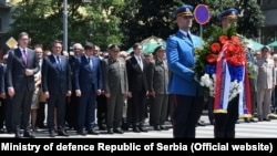 Serbian President Aleksandar Vucic (far left) leads official St. Vitus's Day commemorations in Belgrade on June 28.