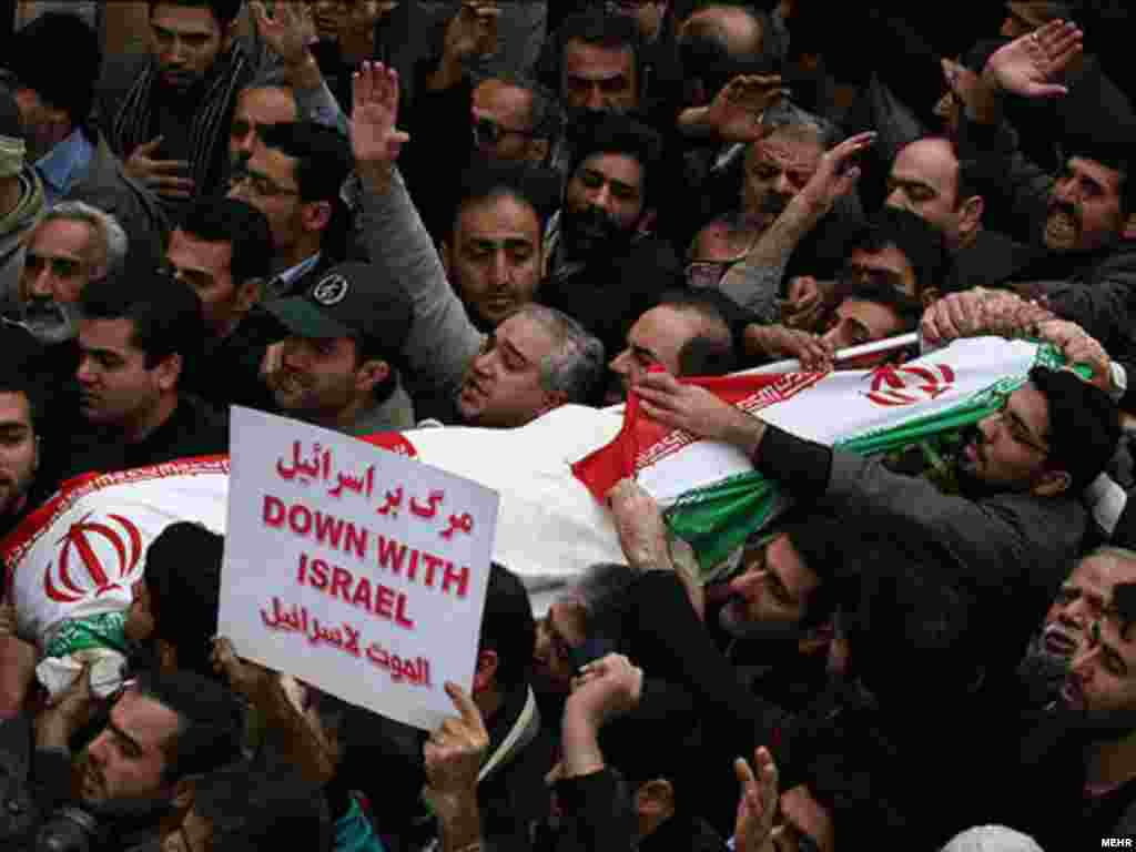 Hundreds of Iranians mourn at the funeral of physics professor Masud Ali Mohammadi in Tehran on January 14. - Mohammadi was killed on January 12 when a bomb-rigged motorcycle exploded outside his home on January 12. State broadcasts quickly blamed ''the Zionist regime, America and their hired agents.''Photo by MEHR