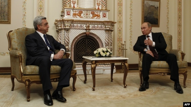 Russian President Vladimir Putin (right) speaks with his Armenian counterpart, Serzh Sarkisian, outside Moscow in March.