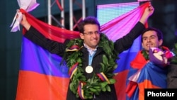 Armenia - Grandmasters Levon Aronian (L) and Gabriel Sargsian celebrate their team's victory in the 2012 World Chess Olympiad in Yerevan's Liberty Square, 10Sep2012.