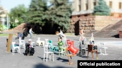 Work goes on at one of the installations at the ARtBatFest Contemporary Art Festival 2012 in downtown Almaty.