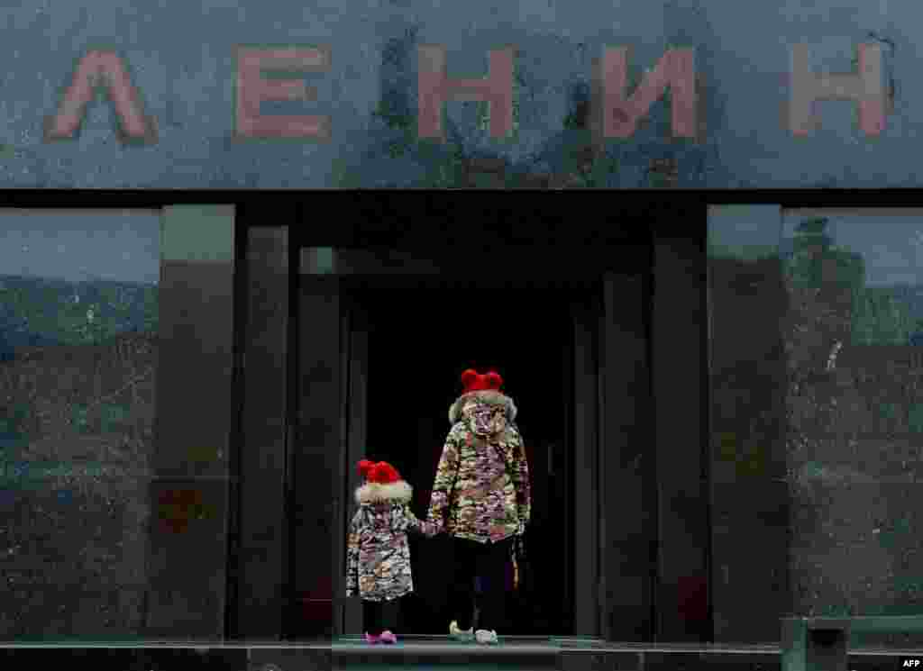 Children enter Lenin's mausoleum while visiting Red Square in Moscow. (AFP/Natalia Kolesnikova)