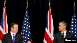 Президент США Барак Обама (справа) и премьер-министр Великобритании Дэвид Кэмерон. Брюссель, 5 июня 2014 года.