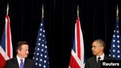 Președintele Barack Obama și premierul britanic David Cameron la conferința de presă comună de la Bruxelles