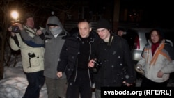 The release from prison of Uladzimer Nyaklyaeu (center left) on January 29