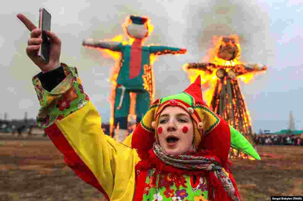 Burning effigies of winter during a celebration in the Kaluga region.