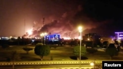 Smoke is seen following a fire at an Aramco factory in Abqaiq, Saudi Arabia, September 14, 2019 in this picture obtained from social media.