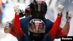 Aleksei Voyevoda captured gold medals in the two-man and four-man bobsled at the Sochi Winter Games. (file photo)