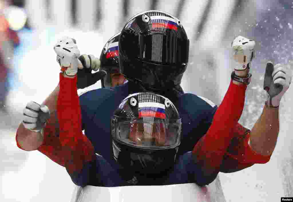Russia's Alexander Zubkov and and his teammates celebrate finishing first during the four-man bobsleigh event. (Reuters/Murad Seze)