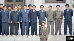 A group of North Koreans visit their side of the truce village of Panmunjom in the Demilitarized Zone separating the two Koreas on September 29.