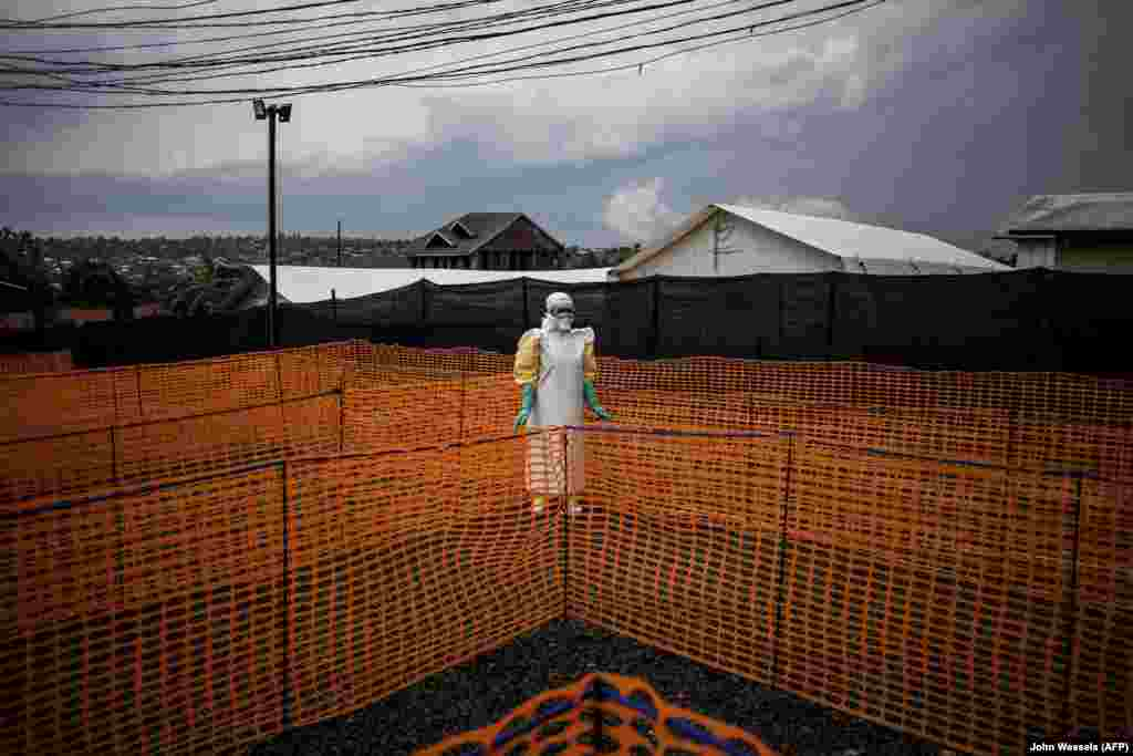 A health worker waits to receive a patient at a new Ebola treatment center in Bunia in the Democratic Republic of the Congo on November 7. The death toll from an Ebola outbreak in the east of the country had risen to more than 200 lives by November 10, the Health Ministry said. (John Wessels/AFP)