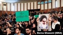 During a gathering at Tehran University one student holding a sign condemning heavy security, as another raises a picture of Ayatollah Khomeini.Sunday, December 09, 2018.