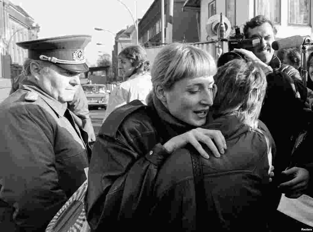 Citizens from East and West Berlin embrace on November 10, 1989.
