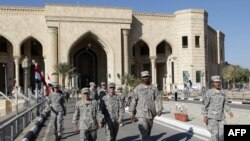 U.S. soldiers leave Al-Fao palace at Camp Victory, one of the last U.S. bases in Iraq, after a special ceremony in Baghdad on December 1.
