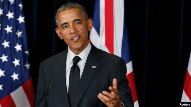 U.S. President Barack Obama speaks during a news conference with the British prime minister at the G7 summit in Brussels.