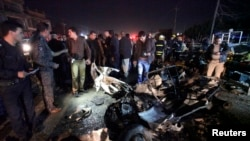 Security forces inspect the site of a car bomb attack in a marketplace in Najaf, Iraq on November 28.