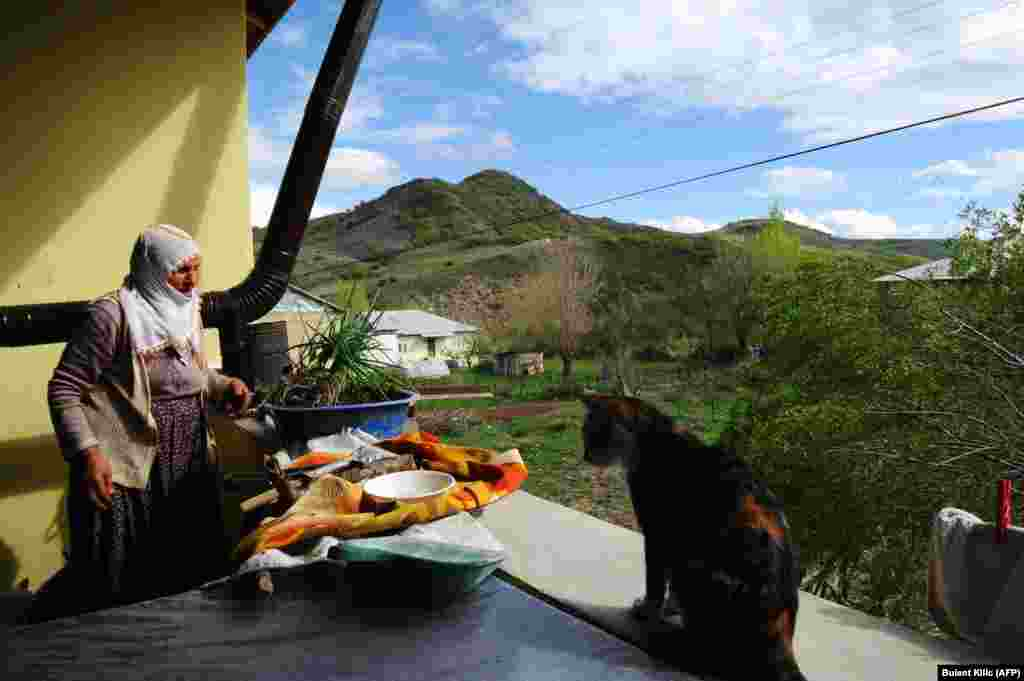 Armenian Muslim Tahire Aslanpencesi works around her house in the village of Mazgirt in Tunceli Province.