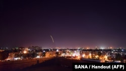 A handout picture released by the official Syrian Arab News Agency (SANA) on September 15, 2018, reportedly shows Syrian air defense batteries responding to what the Syrian state media said were Israeli missiles targeting Damascus international airport.