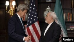 Iranian Foreign Minister Javad Zarif (right) asked for UN intervention one week after meeting with U.S. Secretary of State John Kerry.