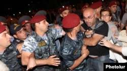 Armenia - Protesters clash with riot police near the Harsnakar restaurant in Yerevan, 8Jul2012.