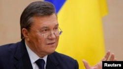 Ousted Ukrainian President Viktor Yanukovych takes part in a news conference in the southern Russian city of Rostov-na-Donu in late February 2014.