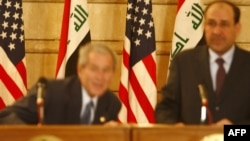 U.S. President George W. Bush (left) ducks to avoid a shoe thrown at him by Iraqi journalist Muntazer al-Zaidi.