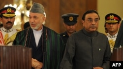 Pakistani President Asif Ali Zardari (right) and his Afghan counterpart, Hamid Karzai, at a previous meeting in Islamabad in September