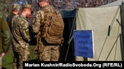 Ukrainian soldiers vote in a special ballot station in the village of Krymske in the Luhansk region on April 21.