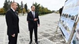 Prezident İlham Əliyev və İmişli Rayon İcra Hakimiyyətinin başçısı Vilyam Hacıyev. 2018