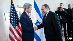 U.S. Secretary of State John Kerry (left) shakes hands with Israeli Foreign Minister Avigdor Lieberman ahead of their meeting in Jerusalem on January 3.