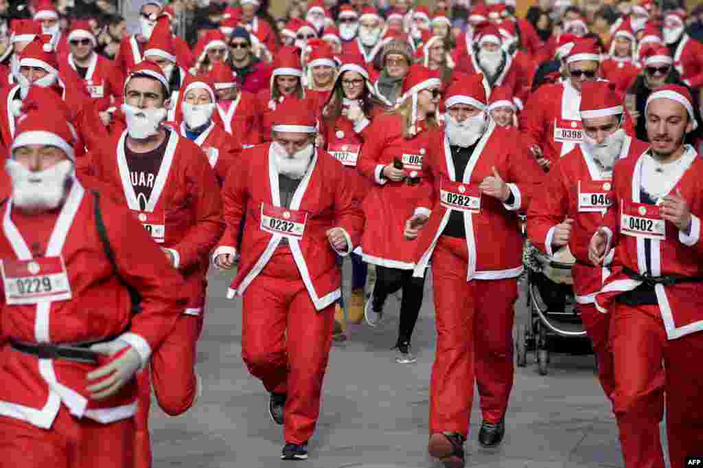 People dressed in Santa Claus costumes take part in a charity race to raise funds for poor families in Kosovo in Pristina. (AFP/Armend Nimani)