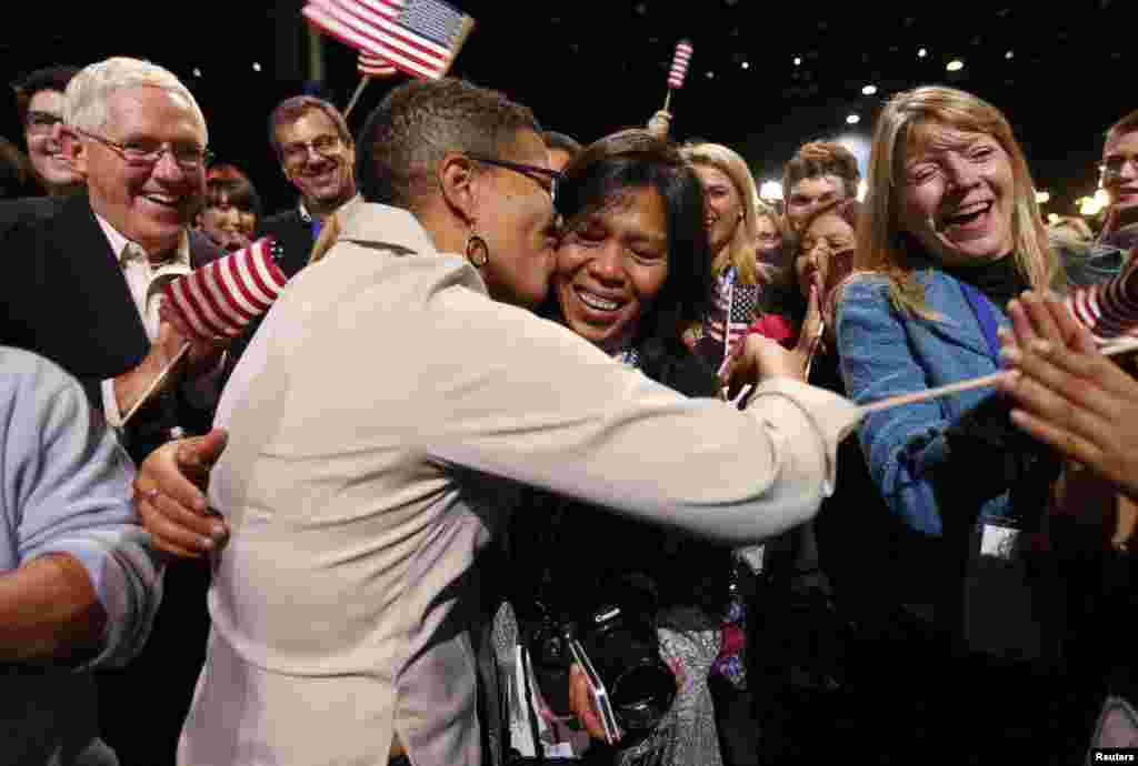 Keesha Patterson (left) of Ft. Washington, Maryland, proposes marriage to her girlfriend Rowan Ha during an election-night rally at Obama's campaign headquarters in Chicago. Obama has expressed support for the legalization of same-sex marriage.